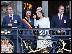 Image licensed to i-Images Picture Agency. 04/08/2014. Mons, Belgium .The Duke and Duchess of Cambridge and Prince Harry on the balcony of Mons Town Hall in Belgium during a reception as part of series of events to commemorate  the 100th anniversary of the start of the First World War. Picture by Stephen Lock / i-Images