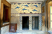 "A modern copy of the ancient Minoan dolphin fresco is installed in place of the original dating from 1500 BC at Knossos palace, Heraklion (Iraklion), Crete, Greece, Europe. Knossos is a Minoan archeological site associated with the Labyrinth and Minotaur of Greek mythology. The Bronze Age palace of Knossos was first built around 1900 BC, destroyed by a large earthquake or foreign invaders in 1700 BC, rebuilt more grandly, then damaged several more times by earthquakes, by invasions, and in 1450 BC by the colossal volcanic eruption of Thera (modern Thira or Santorini). Invading Mycenaeans used Knossos as their capital as they ruled the island of Crete until 1375 BC. Archaeologist Arthur Evans excavated the Palace at Knossos from 1900-1905 and named the Minoan civilization of Crete after king Minos from Greek mythology. Homer's epic poems of the Iliad and Odyssey are the first Greek literature to mention Minos as a king of Knossos, Crete. Minos was son of Zeus and Europa. Every nine years Minos made King Aegeus pick seven men and seven women to go to the Labyrinth to be eaten by the Minotaur, a creature half man and half bull. After his death, legendary Minos became a judge of the dead in Hades. The vast building complex at Knossos is popularly thought to be the site of the Labyrinth, which Greek mythology says was designed by architect Daedalus with such complexity that no one could ever find its exit. Published by Thames & Hudson Ltd in the book ""Art and Archaeology of the Greek World"" by Richard Neer 2012."