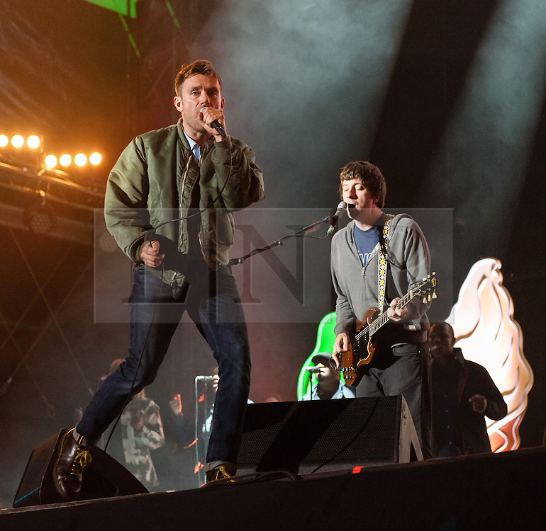 © Licensed to London News Pictures. 13/06/2015. Isle of Wight, UK.   Blur performing live at Isle of Wight Festival 2015, Day 3 Saturday,headlining the main stage.  In this picture - Damon Albarn (left), Graham Cox (right).   Headline acts include The Prodigy, Blur and Fleetwood Mac.   Photo credit : Richard Isaac/LNP