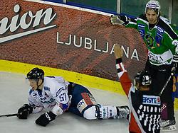 Referee called hooking for Jure Stopar (HDD Tilia Olimpija, #86) on Attila Orban (Sapa Fehervar AV19, #57) during ice-hockey match between HD Tilia Olimpija and HK Acroni Jesenice  in 6th Round of EBEL league, on October 3, 2010 at Hala Tivoli, Ljubljana, Slovenia. (Photo By Matic Klansek Velej / Sportida.com)