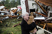 April 29, 2014 - Tupelo, Mississippi, U.S. - <br /> <br /> Deadly Tornadoes Devastate Central and Southern US States<br /> <br /> CONSTANCE LAMBERT embraces her dog after finding it alive when returning to her destroyed home. Lambert was at an event away from her home when the tornado struck and rushed back to check on her pets. <br /> ©Exclusivepix
