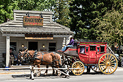 The Castagno Outfitters tourists stagecoach loads passengers at the the Town Square in Jackson Hole, Wyoming.