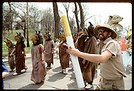 Man with giant cig acts as drum major for kazoo-leech band; Earth Day parade, Forest Park-St Louis Missouri