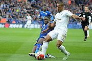 Leicester City forward Jeff Schlupp tackles Swansea City midfielder Wayne Routledge during the Barclays Premier League match between Leicester City and Swansea City at the King Power Stadium, Leicester, England on 24 April 2016. Photo by Alan Franklin.
