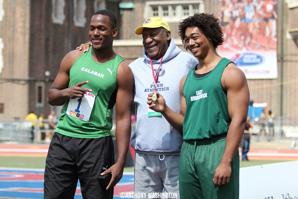 Traves Smikle (left) of Calabar High School (Kingston, Jamaica) and Samuel Mattis of East Brunswick High School pose with Bill Cosby following the High School Boys' Discus Throw Championship awards ceremony at the Penn Relays athletic meet on Friday, April 29, 2011 in Philadelphia, PA.