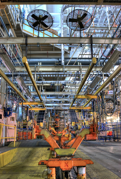 Chassis carrier on tire loader conveyor line of final line with view to upper level Chrysler Newark main assembly plant,HDR image