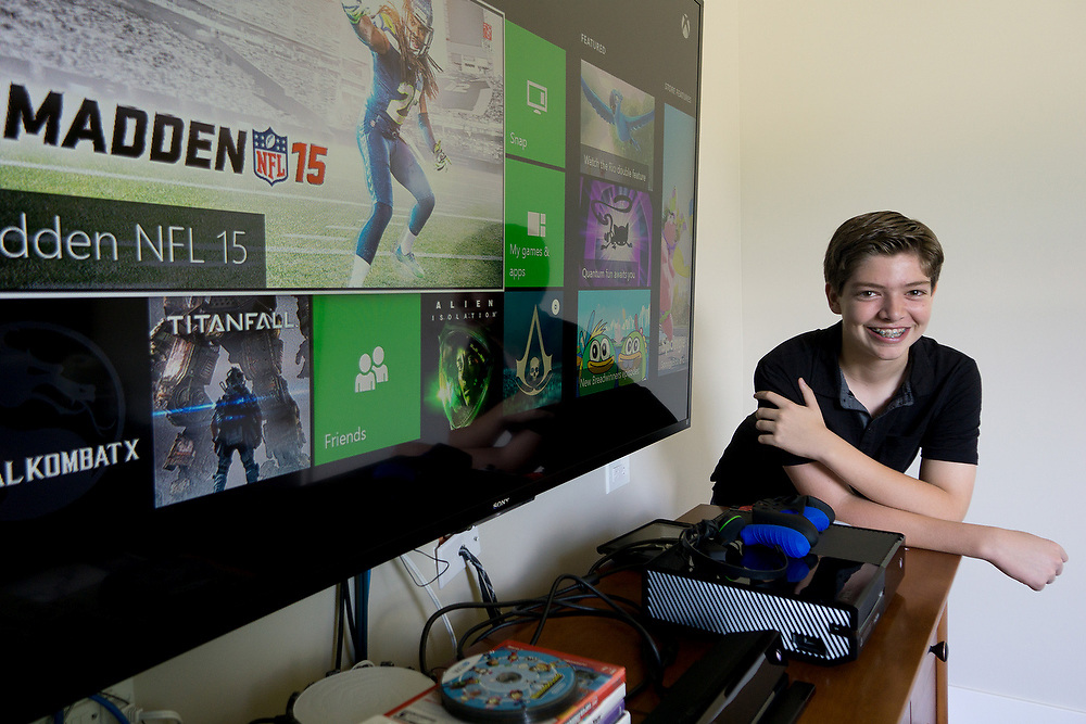 MAY 23, 2015---BOCA RATON, FLORIDA----<br /> Jordan Zietz, 13, poses with some of the vide games and game consoles he rents as part of his business GAMEREEF. Jordan and his sister are rolling in their father's entrepreneurial vein and have successful businesses.