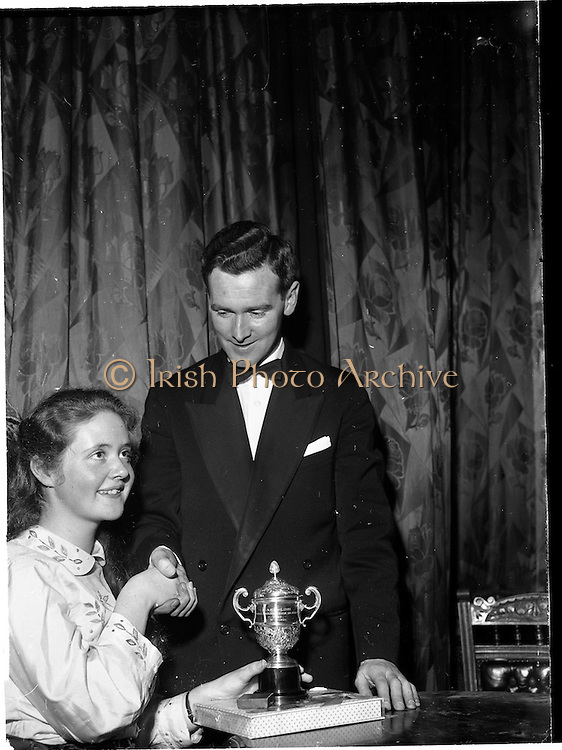 07/11/1959<br /> 11/07/1959<br /> 07 November 1959<br /> All Ireland Final of Gael Linn Children's Singing Competition at Francis  Xavier Hall, Dublin. Picture shows Diarmuid O Broin, Director of the Competition, congratulating  Aine Ní Rinn of Millstreet Cork  who won 1st prize.