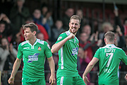 Jordan White (Wrexham AFC) gestures to the Wrexham fans having scored his team's second and put them into the lead. 2-1 to the visitors during the Vanarama National League match between York City and Wrexham FC at Bootham Crescent, York, England on 17 April 2017. Photo by Mark P Doherty.
