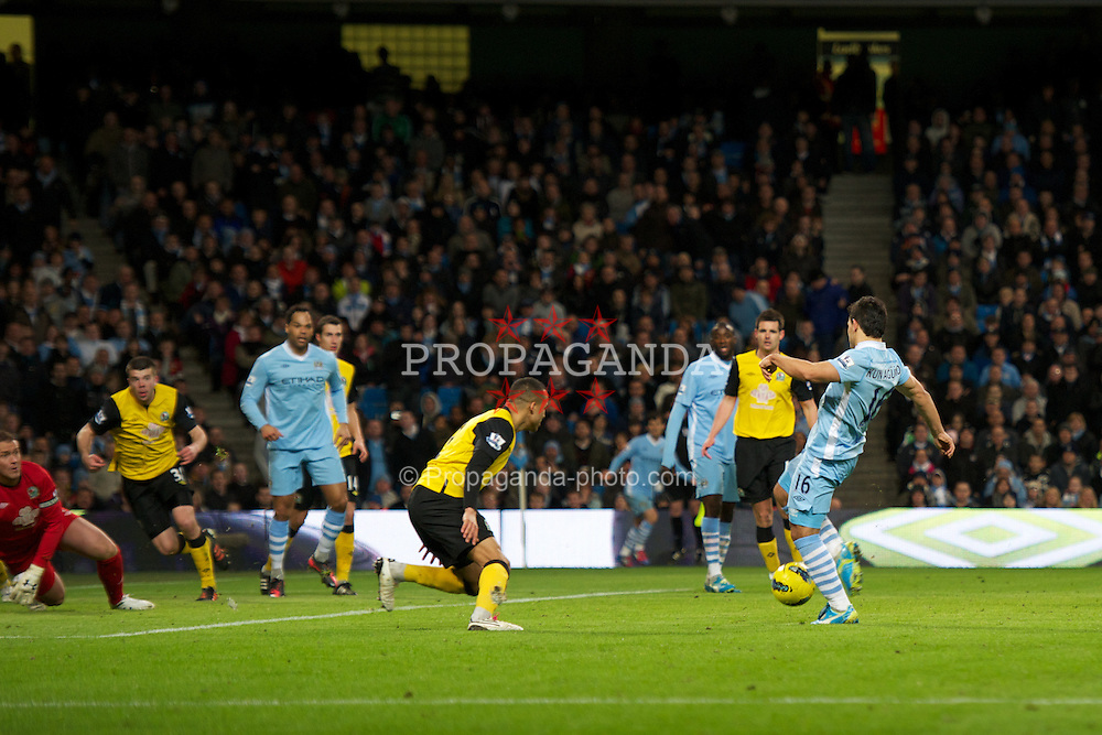 MANCHESTER, ENGLAND - Saturday, February 25, 2012: Manchester City's Sergio Aguero scores the second goal against Blackburn Rovers during the Premiership match at City of Manchester Stadium. (Pic by David Rawcliffe/Propaganda)