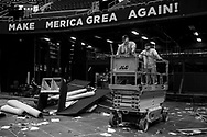 Workers dissemble the stadium set up after the fourth day of the Republican National Convention where Donald Trump became a Republican Party presidential nominee on July 22, 2016 at the Quicken Loans Arena in Cleveland, Ohio.