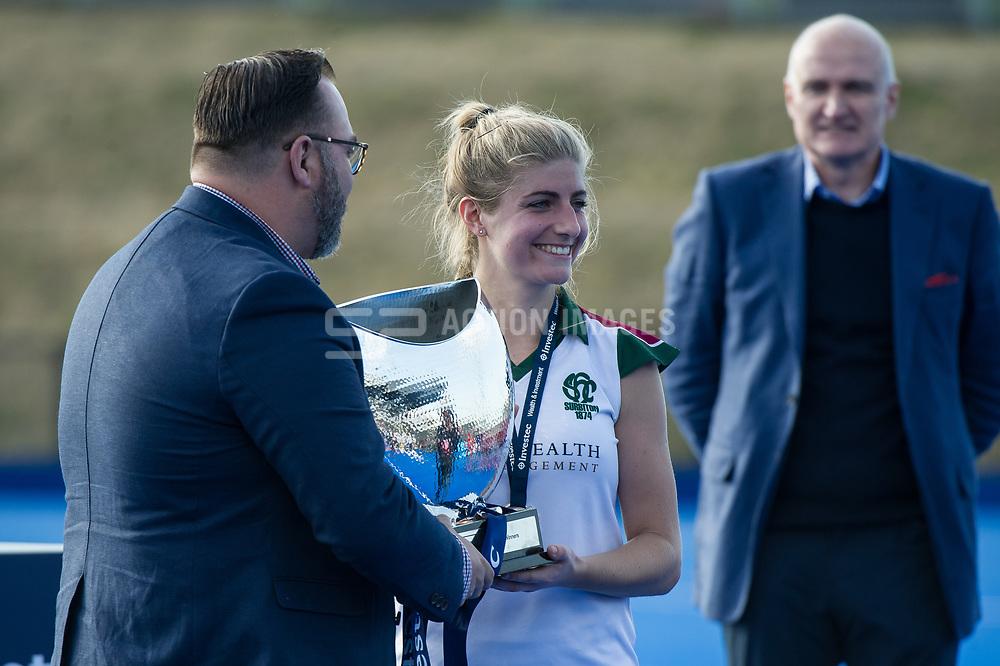 Surbiton's Sarah Haycroft is presented with the trophy. Holcombe v Surbiton - Investec Women's Hockey League Final, Lee Valley Hockey & Tennis Centre, London, UK on 23 April 2017. Photo: Simon Parker