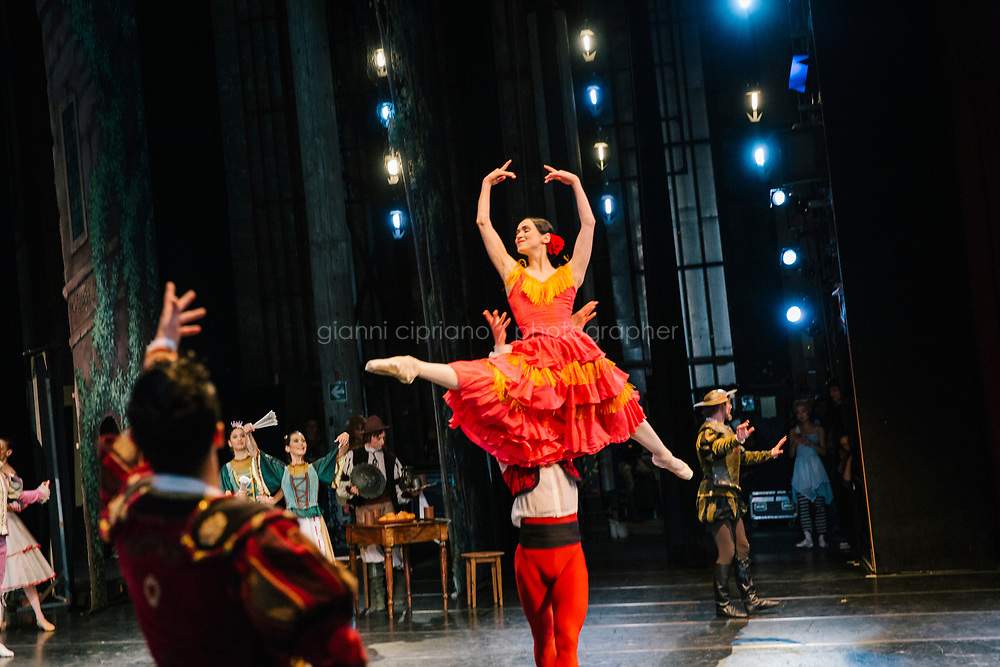 PALERMO, ITALY - 18 FEBRUARY 2018: Etoile dancer Olesja Novikova (center), who interprets the role of  Kitri in &quot;Don Quixote&quot;, performs during the dress rehearsal at the Teatro Massimo in Palermo, Italy, on February 18th 2018.<br /> <br /> The Teatro Massimo Vittorio Emanuele is an opera house and opera company located  in Palermo, Sicily. It was dedicated to King Victor Emanuel II. It is the biggest in Italy, and one of the largest of Europe (the third after the Op&eacute;ra National de Paris and the K. K. Hof-Opernhaus in Vienna), renowned for its perfect acoustics. It was inaugurated in 1897.