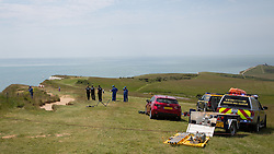 © Licensed to London News Pictures. 13/06/2014. Emergency services searched the coastline at the foot of Beachy Head in East Sussex today. A car was parked at the top of Beachy Head next to the point at which Coastguard teams responded both by air and on the ground. The police were also in attendance. Beachy Head is a notorious suicide spot and about 20 take place each year. Credit : LNP