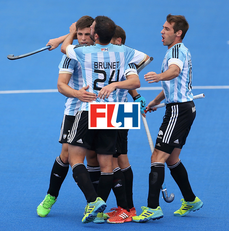 LONDON, ENGLAND - JUNE 24:  Lucas Vila of Argentina (obscured) celebrates scoring their teams first goal with teammates during the semi-final match between Argentina and Malaysia on day eight of the Hero Hockey World League Semi-Final at Lee Valley Hockey and Tennis Centre on June 24, 2017 in London, England.  (Photo by Steve Bardens/Getty Images)