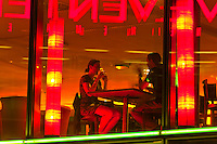 A couple having a drink at the Corroboree Australian bar and restaurant in the Sony Center, Potsdamer Platz, Mitte, Berlin, Germany