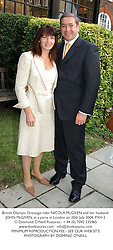 British Olympic Dressage rider NICOLA McGIVEN and her husband JOHN McGIVEN, at a party in London on 20th July 2004.PXH 2