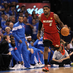 Jun 12, 2012; Oklahoma City, OK, USA;  Miami Heat small forward LeBron James (6) brings the ball up court against the Oklahoma City Thunder during the first quarter of game one in the 2012 NBA Finals at the Chesapeake Energy Arena.  Mandatory Credit: Derick E. Hingle-US PRESSWIRE