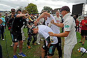 Surrey are County Champions - Rory Burns of Surrey is sprayed with beer by his celebrating team mates as he is interviewed by TV during the final day of the Specsavers County Champ Div 1 match between Worcestershire County Cricket Club and Surrey County Cricket Club at New Road, Worcester, United Kingdom on 13 September 2018.