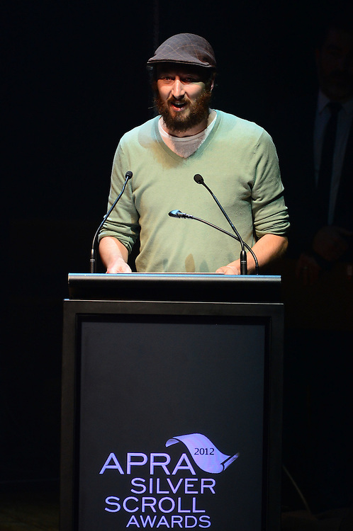 Dave Baxter, winner of Most Performed work in NZ, on stage at the APRA Silver Scroll Awards 2012. Auckland Town Hall. 13 September 2012.