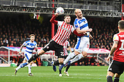 Brentford Defender Henrik Dalsgaard (22) and Queens Park Rangers Defender Toni Leistner (37) in action during the EFL Sky Bet Championship match between Brentford and Queens Park Rangers at Griffin Park, London, England on 2 March 2019.