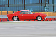 "1967 Chevrolet Camaro - Custom vermillion red .454ci (7.4L) big block V8, 3-spd auto (TH350), LSD 3.5:1, 31-spline billet axles, custom tailshaft, Centerline Autodrag 15x7"" & 15x8.5"" Wheels, 2"" cowl hood, metal trunk spoiler, RS taillights & indicators .Docklands, Port Melbourne, Victoria.20th December 2009 .(C) Joel Strickland Photographics.Use information: This image is intended for Editorial use only (e.g. news or commentary, print or electronic). Any commercial or promotional use requires additional clearance."