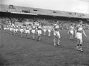 Dublin and Derry march out onto the pitch before the start of the All Ireland Senior Gaelic Football final Dublin vs Derry in Croke Park on 28th September 1958. Dublin 2-12 Derry 1-9.