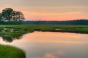 Setting sun on the Great Marsh, Newbury, Massachusetts. Part of a 25,000 acre salt marsh, extending from Cape Ann Massachusetts to Southern, New Hampshire