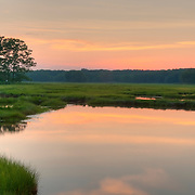 Setting sun on the Great Marsh, Newbury, Massachusetts. Part of a 25,000 acre salt marsh, extending from Cape Ann Massachusetts to Southern, New Hampshire
