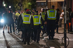 © Licensed to London News Pictures. 19/07/2020. London, UK. Metropolitan police officers depart the area after dispersing the crowd. A crowd has been dispersed by police from Kingsington Park Road in Notting Hill. The crowd was ordered to leave the area under a Section 35 order. The Crowd were generally compliant and left the area peacefully. Photo credit: Peter Manning/LNP