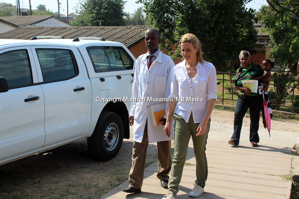 Matero Reference Clinic Senior Clinical officer Mr. Jones Mwamba (l) talks to Gabby Logan in Lusaka, Zambia  on Wednesday 12 November 2014.