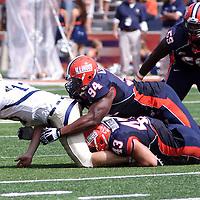 Illinois LB Mason Monheim #43 and DL Akeem Spence #94 tackles Charleston's QB Briar Van Brunt #13 at Memorial Stadium, Champaign, Illinois, September 15, 2012. George Strohl/AI Wire.