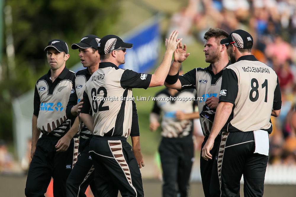 The Black Caps celebrate a wicket during the second T20 match of the ANZ International T20 series - New Zealand Black Caps v Pakistan played at Seddon Park, Hamilton, New Zealand on Sunday 17 January 2016. Copyright Photo:  Bruce Lim / www.photosport.nz