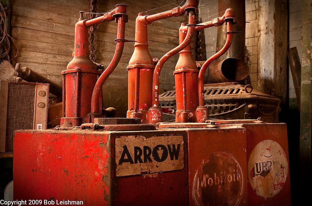 Old motor oil dispenser