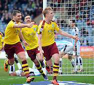 Ben Mee (r) of Burnley celebrates scoring the 3rd goal against Huddersfield during the Sky Bet Championship match at the John Smiths Stadium, Huddersfield<br /> Picture by Graham Crowther/Focus Images Ltd +44 7763 140036<br /> 12/03/2016