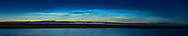 A panorama of a fine display of noctilucent clouds across the northern horizon over an angle of about 60&deg;. This was on June 26, 2018 at about 11:45 pm. Capella is just left of centre. The display faded as the solar illumination dropped and the clouds darkened from the top down. This was from the small pond near home in southern Alberta. <br /> <br /> This is a stitch of 7 segments, each 2 seconds at f/2.8 with the 85mm Rokinon lens and Canon 6D MkII at ISO 400. Stitched with ACR.