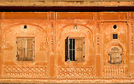 Three shuttered windows in the Pink City in Jaipur, Rajasthan, India