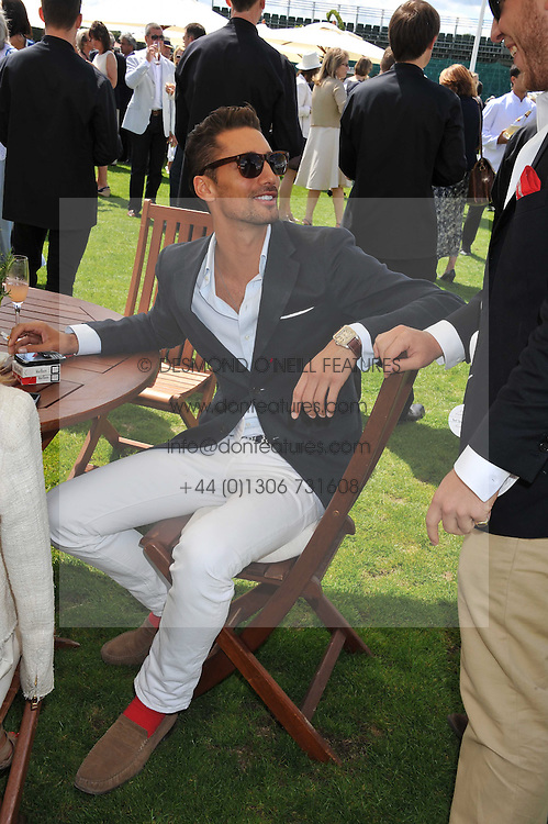 HUGO TAYLOR at the 27th annual Cartier International Polo Day featuring the 100th Coronation Cup between England and Brazil held at Guards Polo Club, Windsor Great Park, Berkshire on 24th July 2011.