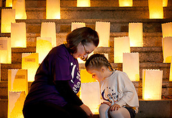 Repro Free: 25/20/2010 Siofra O'Sullivan (5) is pictured with cancer survivor Nicola Elmer during a Candle of Hope ceremony to mark the launch of the Global Relay For Life European Summit which is being hosted by the Irish Cancer Society in Dublin today. Pic Andres Poveda..The Global Relay For Life European Summit is an international symposium focusing on how ?We Save Lives? through Relay For Life in communities across the globe. Relay For Life is a 24 hour community celebration event which sees teams of participants take to the track overnight to symbolise the fact that cancer never sleeps. The Irish Cancer Society was chosen this year to host the Summit, which is organised by the American Cancer Society, from the 25th-27th of October 2012....To find out more about Relay For Life, visit www.relayforlife.ie or call 1850 60 60 60. ..ENDS. .For further information, please contact:.Grainne O'Rourke / Órla Sheils.Communications, Irish Cancer Society.E: gorourke@irishcancer.ie / osheils@irishcancer.ie .T: 01 231 0546 / 01 231 055 / 087 9707709