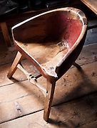 Old 3 leg chair. Visit the farm museum of Rygnestadtunet (at Nordigard, in Nørdre Rygnestad, near Valle, Setesdal, Aust-Agder, Norway) to admire a unique 1590 three-story storehouse, a farmhouse with open-hearth room dating from before the Black Death (1349-50), and 15th century painted textiles.