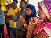 """05 SEPTEMBER 2016 - BANGKOK, THAILAND:  People during the first day of Ganesha Chaturthi celebrations at Shiva Temple in Bangkok. Ganesha Chaturthi also known as Vinayaka Chaturthi, is the Hindu festival celebrated on the day of the re-birth of Lord Ganesha, the son of Shiva and Parvati. The festival, also known as Ganeshotsav (""""Festival of Ganesha"""") is observed in the Hindu calendar month of Bhaadrapada. The date usually falls between 19 August and 20 September. The festival lasts for 10 days, ending on Anant Chaturdashi. Ganesha is a widely worshipped Hindu deity and is revered by many Thai Buddhists. Ganesha is widely revered as the remover of obstacles, the patron of arts and sciences and the deva of intellect and wisdom.     PHOTO BY JACK KURTZ"""