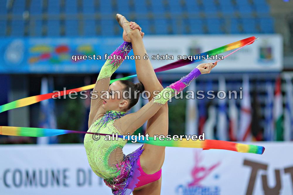 Jerõgina Karina during qualifying at ribbon in Pesaro World Cup at the Adriatic Arena on April 27, 2013. Karina is an Estonian individual gymnast born January 7, 1997 in Tallin, Estonia.
