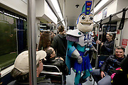 Zap Gridlock joins the riders of the U Link train on launch day for Sound Transit's light-rail from Capitol Hill station to the University Station at Husky Stadium on Sat. March 19, 2016<br />