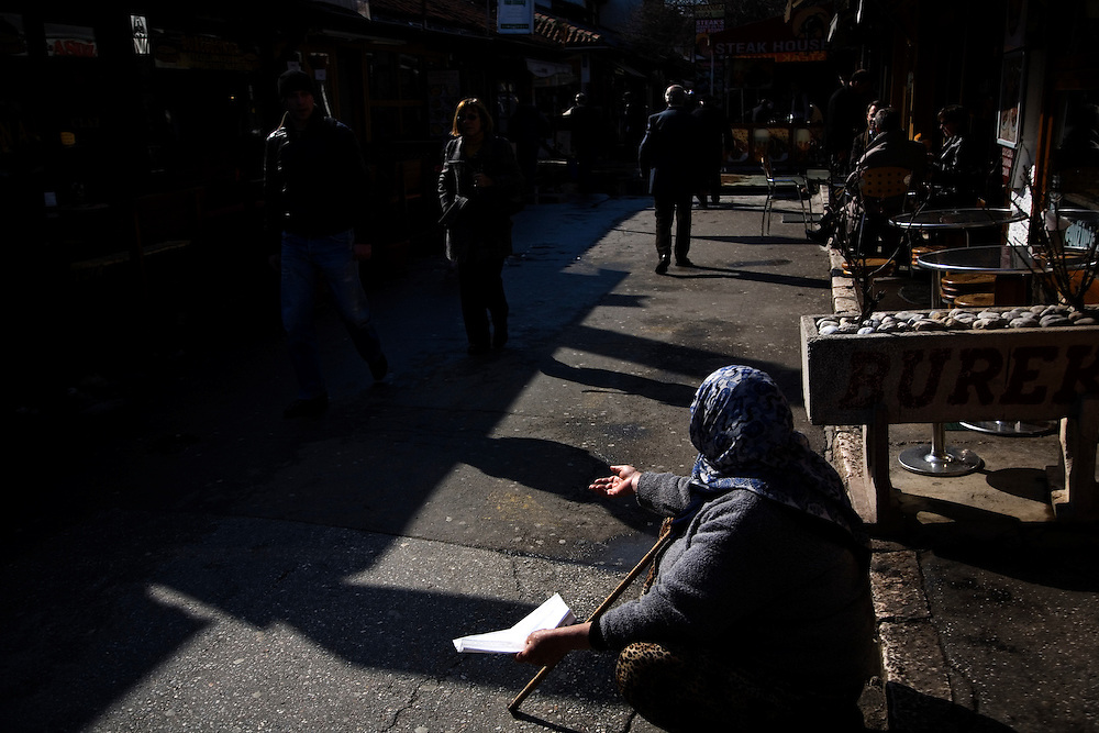 A Roma woman asks for change in the Bascarsija section of Sarajevo, a famous Ottoman-Turkish quarter.