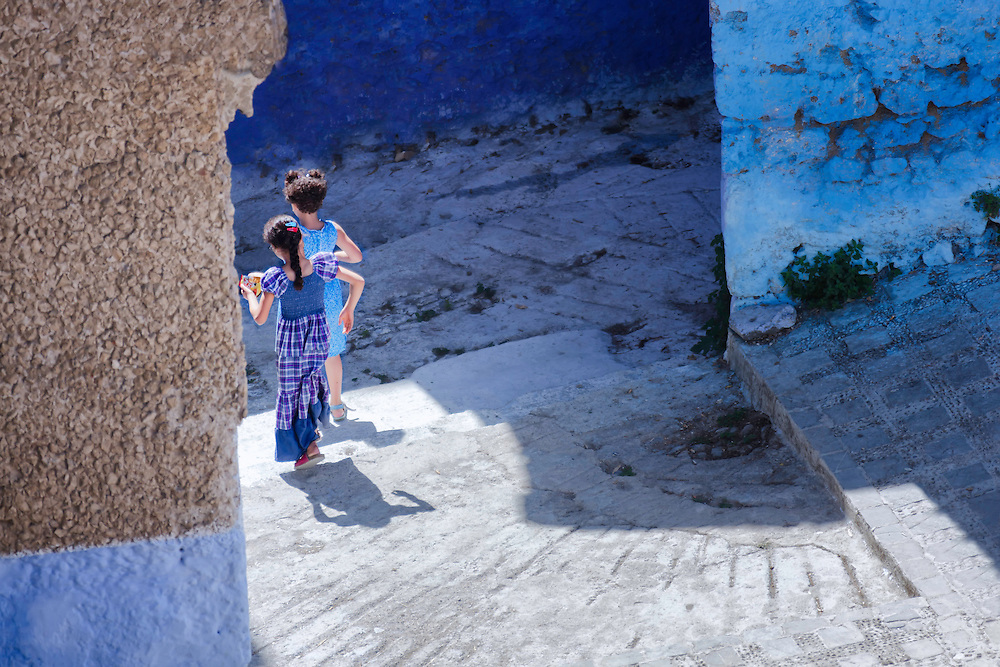 Two girls in the medina of Chefchaouen, Morocco.