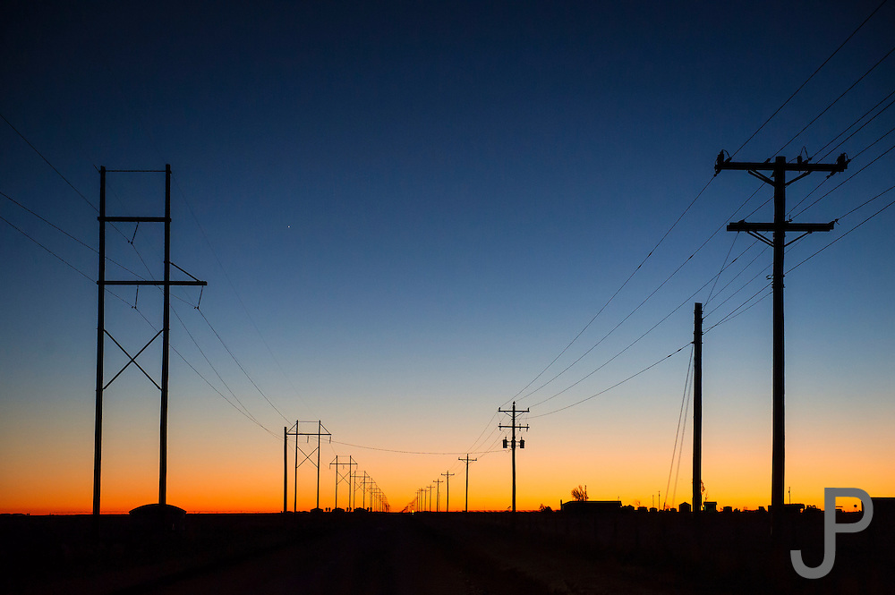 The sun sets behind electrical utility lines in the Oklahoma panhandle.