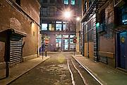 Empty Dangerous Urban Alley at Night in Manhattan, New York City.