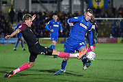 AFC Wimbledon striker Joe Pigott (39) battles for possession with Peterborough United defender Frankie Kent (6) during the EFL Sky Bet League 1 match between AFC Wimbledon and Peterborough United at the Cherry Red Records Stadium, Kingston, England on 18 January 2020.