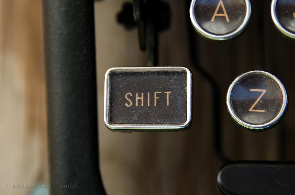 "Close-up of antique typewriter ""shift"" key."