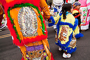 "03 DECEMBER 2011 - PHOENIX, AZ:    Children with sequined Simpson characters on their outfits in a procession to honor the Virgin of Guadalupe in Phoenix Saturday. The Phoenix diocese of the Roman Catholic Church held its Sixth Annual Honor Your Mother Day Saturday to honor the Virgin of Guadalupe. According to Mexican Catholic tradition, on December 9, 1531 Juan Diego, an indigenous peasant, had a vision of a young woman while he was on a hill in the Tepeyac desert, near Mexico City. The woman told him to build a church exactly on the spot where they were standing. He told the local bishop, who asked for some proof. He went back and had the vision again. He told the lady that the bishop wanted proof, and she said ""Bring the roses behind you."" Turning to look, he found a rose bush growing behind him. He cut the roses, placed them in his poncho and returned to the bishop, saying he had brought proof. When he opened his poncho, instead of roses, there was an image of the young lady in the vision. The Virgin is now honored on Dec 12 in Catholic churches throughout Latin America and in Hispanic communitied in the US.  PHOTO BY JACK KURTZ"